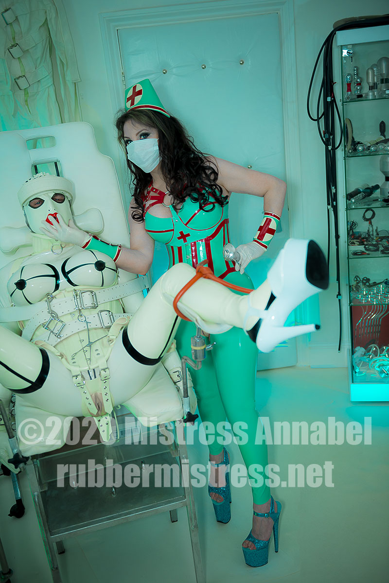 Mistress Annabel with clinical rubber doll at London Rubber Clinic. rubbermistress.net